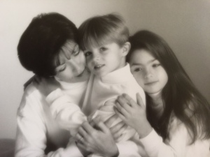 Marti hugging two of her children while fighting breast cancer in 1998.